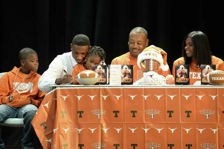 Jalen Green is surrounded by his family as he signs a commitment to play football for the University of Texas, at Heights High School in Houston, TX on Wednesday, December 20, 2017.