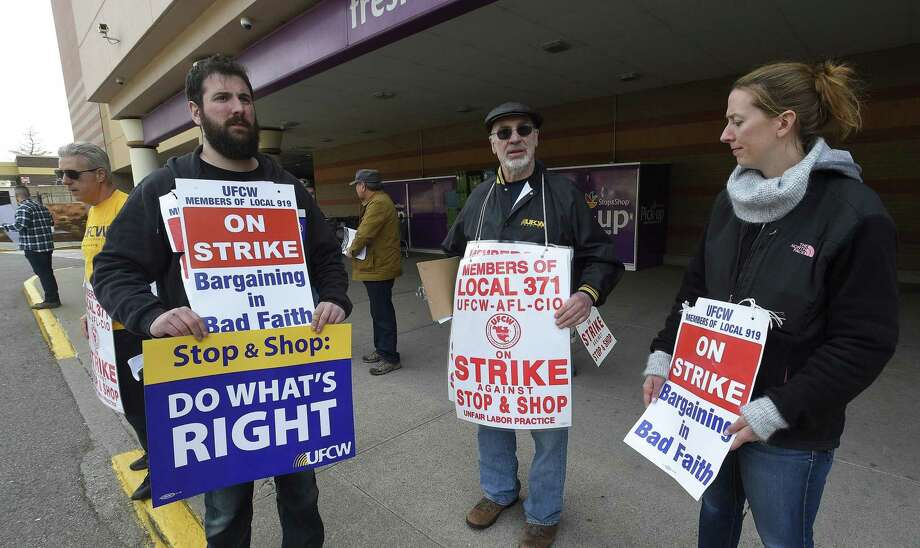 Striking Stop & Shop supermarket employees stand on the picket line on Friday, April 12, 2019, outside a one of the stores in Stamford, Conn. Unionized workers in three states walked off the job on Thursday over stalled contract negotiations. Photo: Matthew Brown / Hearst Connecticut Media / Stamford Advocate