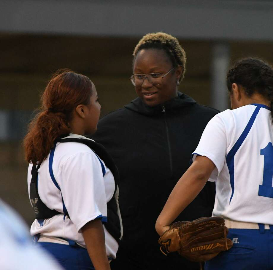 Dekaney Head Softball Coach ?????????????, center, pumps up her battery of catcher Alexa Villa, left, and ???????? in the top of the 4th inning of their District 16-6A matchup at Dekaney High School on April 12, 2019. Photo: Jerry Baker, Houston Chronicle / Contributor / Houston Chronicle