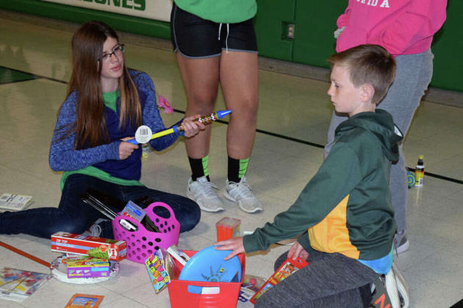 Members of the Salem Lutheran School track and field and volleyball teams performed good deeds Friday in honor of Good Friday. Photo: Samantha McDaniel-Ogletree | Journal-Courier
