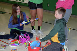 Members of the Salem Lutheran School track and field and volleyball teams performed good deeds Friday in honor of Good Friday.