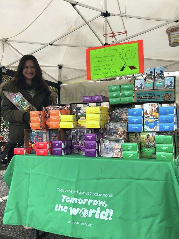 Sierra Rechak, 17, sells Girl Scout cookies at her seasonal booth in the Rite Aid parking lot in Wilton. (Jennifer Patterson / Times Union) Photo: Jennifer Patterson / Times Union