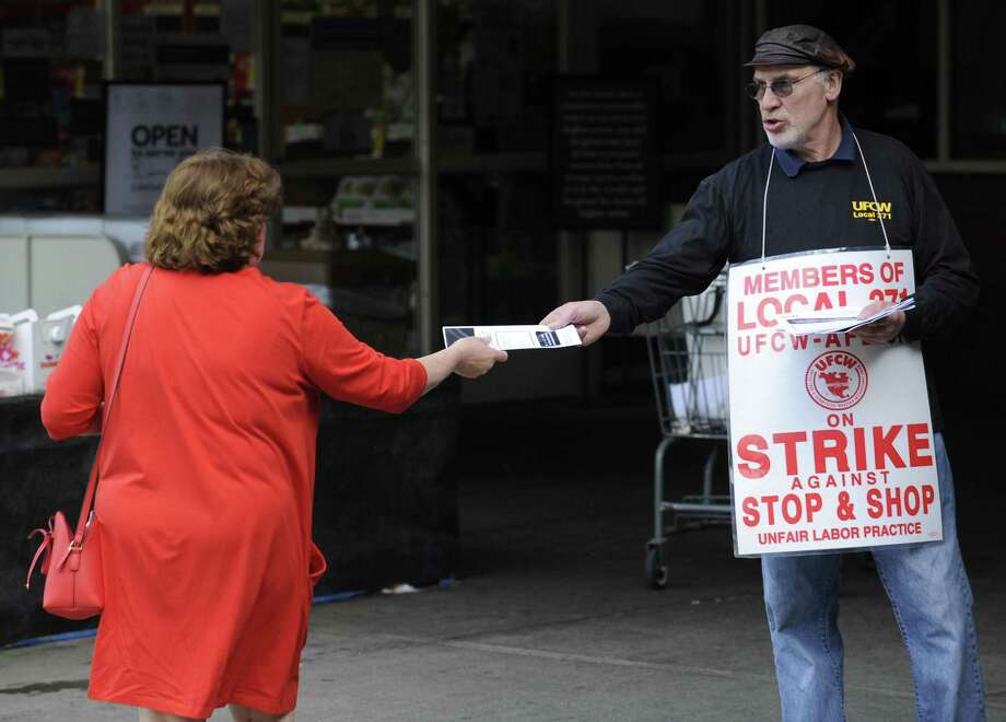 Terry McCaffrey of Stamford, Union Shop Stewart for Local #371, passes out a flyer to a customer of Stop & Shop as union employees walk the strike line Thursday, April 19, 2019 at one of the Stamford, Conn. stores. Photo: Matthew Brown / Hearst Connecticut Media / Stamford Advocate