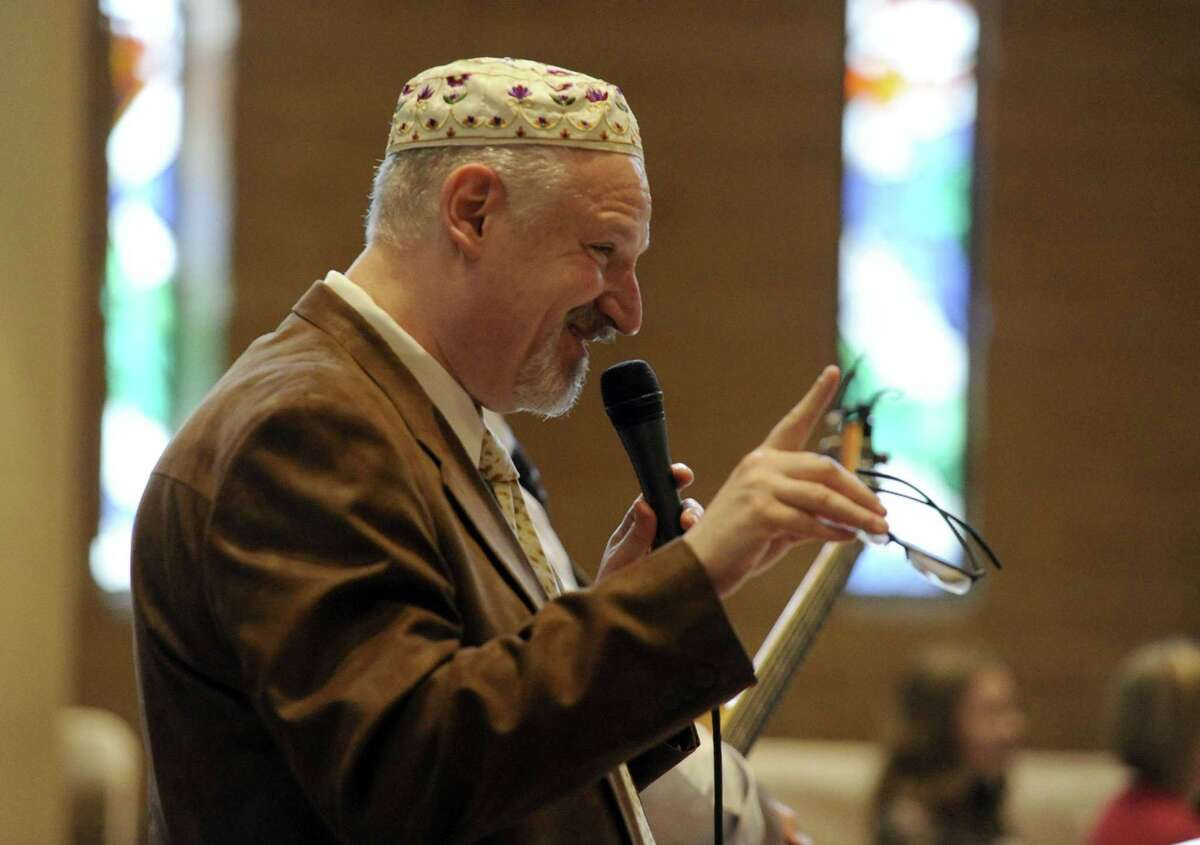 Rabbi Mitchell M. Hurvitz reads a passage during an Interfaith Passover Seder at Temple Sholom on Friday, April 19, 2019 in Greenwich, Connecticut. The Passover Seder is a Jewish ritual feast that marks the beginning of the Jewish holiday of Passover.