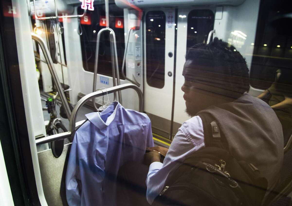 After finishing his work shift near midnight, Jahvuon King-Registe rides the Light Rail Wednesday, June 13, 2018, in Houston on his way to the TSU/UH Athletic District stop where he meets his mother and together they drive to their home located in Pearland. King-Registe is one of hundreds of college students impacted by Hurricane Harvey.