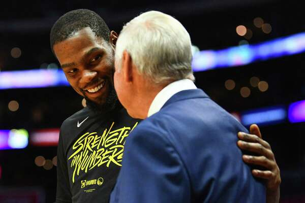 Despite a 50-year age difference, Kevin Durant, left, and Jerry West have a good relationship.