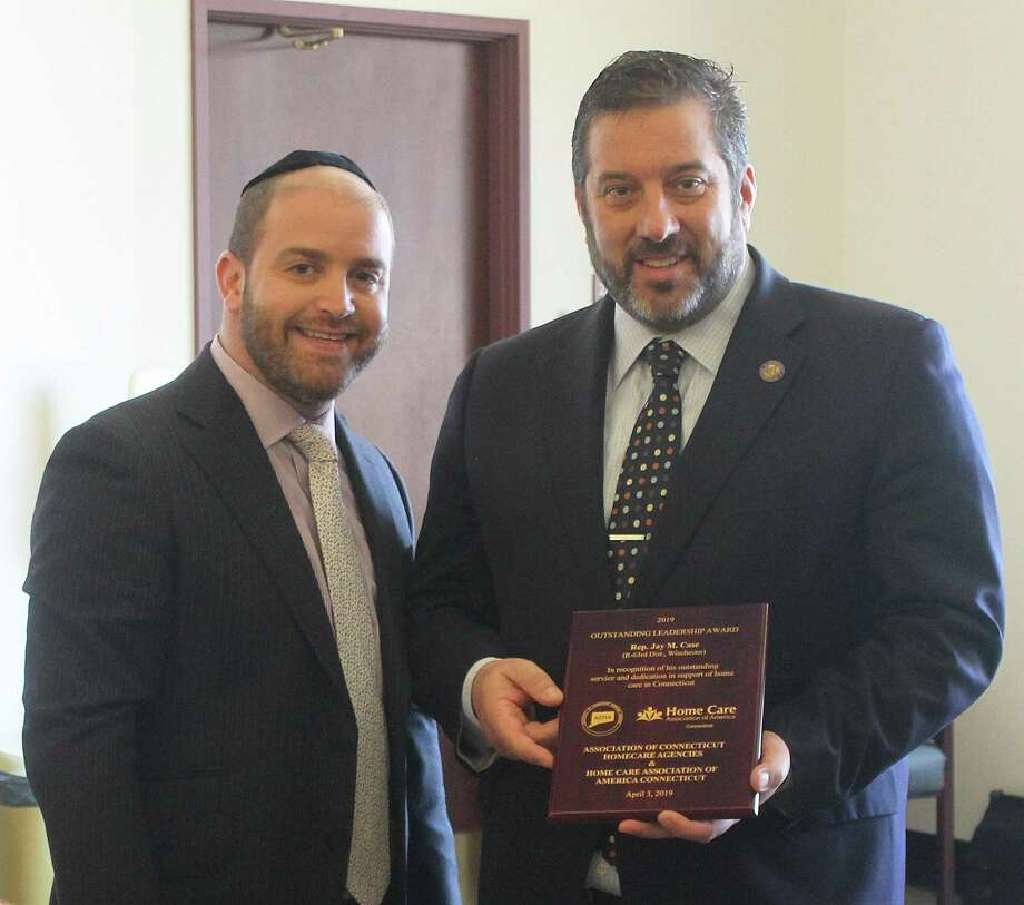 State Rep. Jay Case (R-Winsted) was recognized April 3 by the Association of Homecare Agencies & Home Care Association of America Connecticut. The organization provided him with recognition this morning with their 2019 Outstanding Leadership Award. Above, Chaim Gewirtzman, left, presents the award to Case, right, at the Legislative Office Building. Photo: Contributed Photo