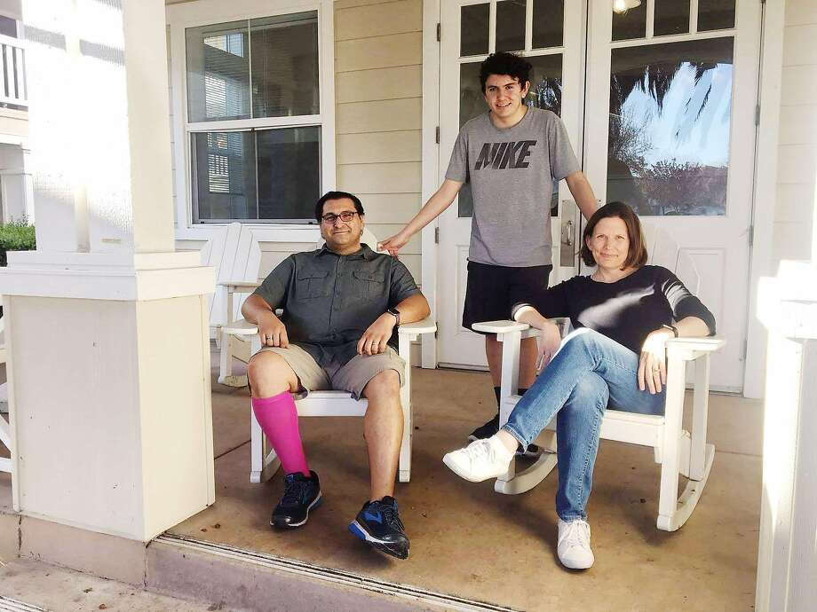 The Valentini family — Loren (left), Alex and Suzy — live at Casa del Maestro, an affordable housing complex built for teachers in Santa Clara. Photo: Fensterwald / EdSource