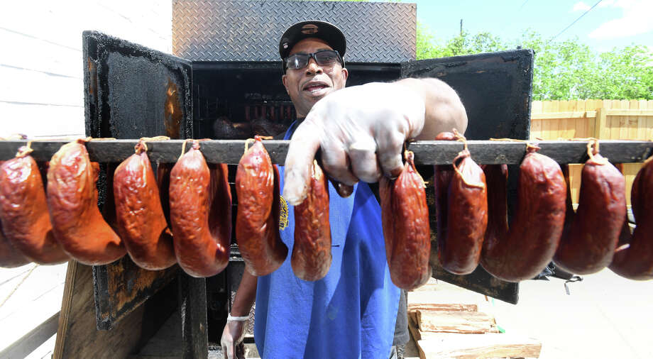 Charles Brewer holds a rack of links at his barbecue restaurant in Beaumont Friday. Brewer's place Charlie's has been recognized by Texas Monthly and is on the magazine's midterm list of best barbecue in Texas. Photo taken Friday, 4/19/19 Photo: Drone Image: Guiseppe Barranco/T / Guiseppe Barranco ©