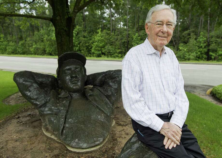 "Coulson Tough, 93, poses for a portrait at the sculpture ""The Dreamer"" by David Phelps, Thursday, April 18, 2019, in The Woodlands. Tough was comissioned by George Mitchell to help design and build The Woodlands. He also helped The Woodlands Township's collection of 51 outdoor sculptures. Photo: Jason Fochtman, Houston Chronicle / Staff Photographer / © 2019 Houston Chronicle"