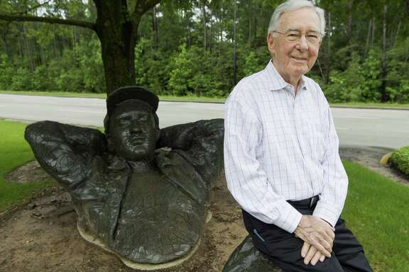 """Coulson Tough, 93, poses for a portrait at the sculpture """"The Dreamer"""" by David Phelps, Thursday, April 18, 2019, in The Woodlands. Tough was comissioned by George Mitchell to help design and build The Woodlands. He also helped The Woodlands Township's collection of 51 outdoor sculptures."""