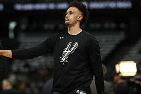 =San Antonio Spurs guard Derrick White (4) in the first half of Game 2 of an NBA basketball playoff series Tuesday, April 16, 2019, in Denver. (AP Photo/David Zalubowski)