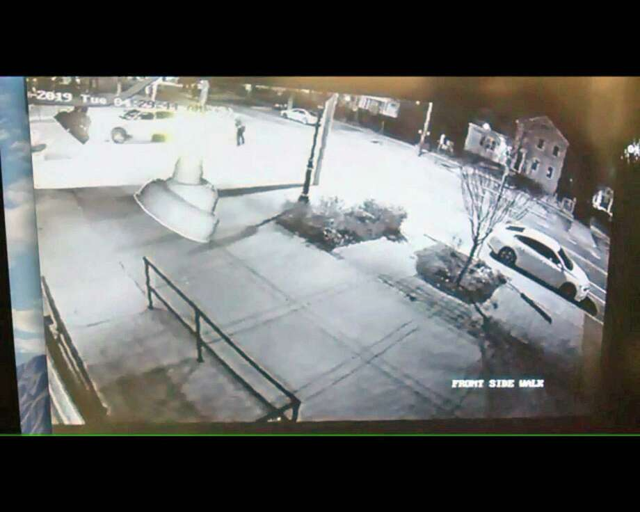 A screenshot of the video posted by Fox 61 that shows another angle of the police-involved shooting in New Haven. This new footage was posted by the news organization April 19. The non-fatal shooting took place on Tuesday, April 16. Photo: Contributed Photo / Connecticut Post Contributed
