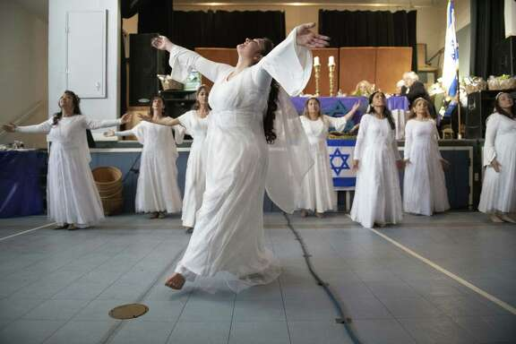 San Antonio area residents celebrate the annual community-wide Passover Seder at the Baruch Hashem Messianic synagogue on Friday, April 19, 2019. The ancient Jewish event is rich with rituals and traditions. It marks the time when the Pharaoh finally freed the Israelites from their slavery after Egypt went through all the plagues such as frogs, locusts, boils, and the final one was the death of every firstborn in every Egyptian household. The Jewish people were spared, however, because they dabbed lamb's blood on their doorsills as God told them to do, indicating to the Angel of Death that the angel was to pass over that home because a Jewish family was living there.