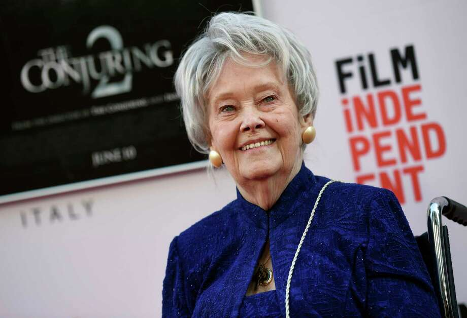 """FILE - In this June 7, 2016, file photo, paranormal investigator and film consultant Lorraine Warren poses at the premiere of the film """"The Conjuring 2"""" during the Los Angeles Film Festival at the TCL Chinese Theatre in Los Angeles. Warren, whose decades of ghost-hunting cases alongside her late husband were the inspiration for films such as ?The Conjuring? and ?The Amityville Horror,? died Thursday night, April 18, 2019, at her Connecticut home. She was 92.  (Photo by Chris Pizzello/Invision/AP, File) Photo: Chris Pizzello / Invision"""
