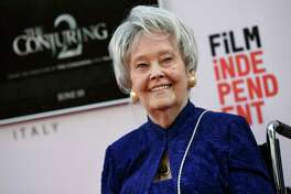 """FILE - In this June 7, 2016, file photo, paranormal investigator and film consultant Lorraine Warren poses at the premiere of the film """"The Conjuring 2"""" during the Los Angeles Film Festival at the TCL Chinese Theatre in Los Angeles. Warren, whose decades of ghost-hunting cases alongside her late husband were the inspiration for films such as ?The Conjuring? and ?The Amityville Horror,? died Thursday night, April 18, 2019, at her Connecticut home. She was 92. (Photo by Chris Pizzello/Invision/AP, File)"""