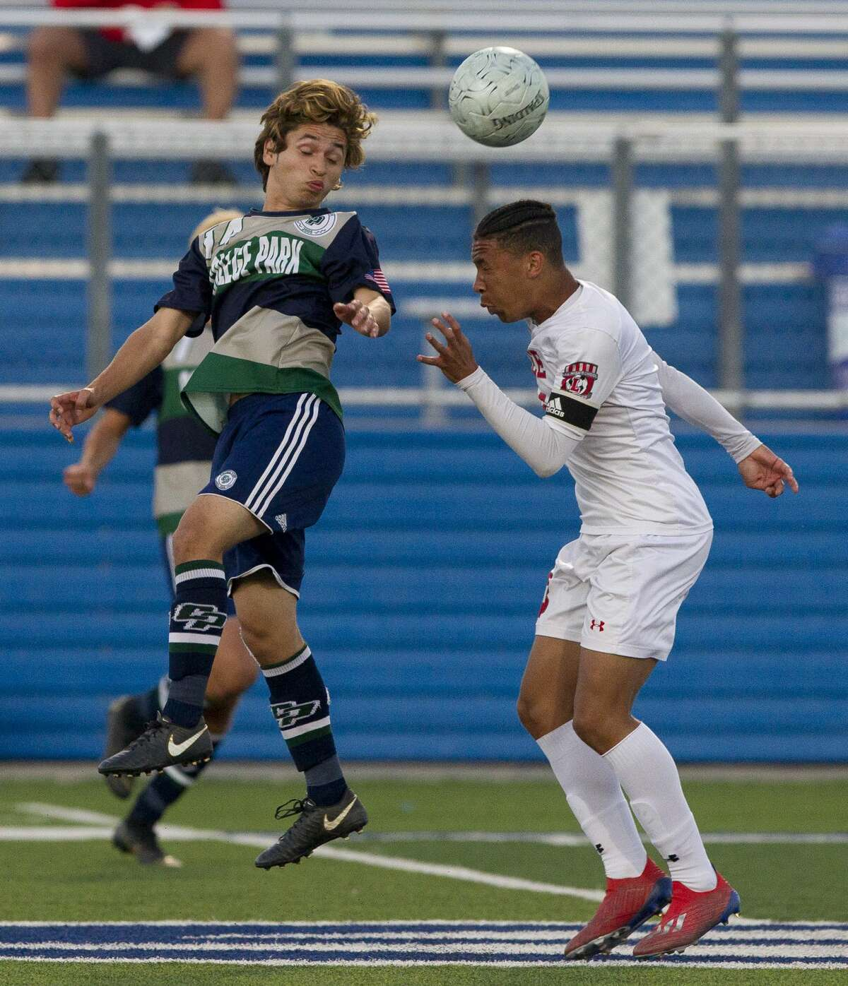 College Park forward Jesse Botello (14) heads the ball in the first period of a Class 6A boys state semifinal match during the UIL State Soccer Championships at Birkelbach Field, Friday, April 19, 2019, in Georgetown.