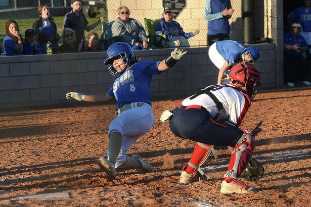 Hardin - Jefferson's Mackenzie Comeaux awaits the throw to home as Hamshire - Fannett's Madison Ramsey slides into the plate during their district match-up Friday in Sour Lake. Photo taken Friday, April 19, 2019 Kim Brent/The Enterprise