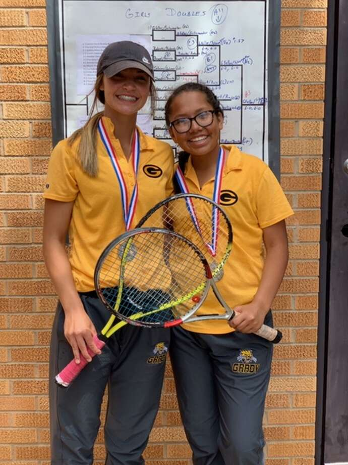The Grady girls doubles team of Raina Short, left, and Zoey Ruiz  celebrate with their silver medals after finishing second at the Region  I-A Tennis Tournament to qualify for the state tournament, April 18 in  Levelland.