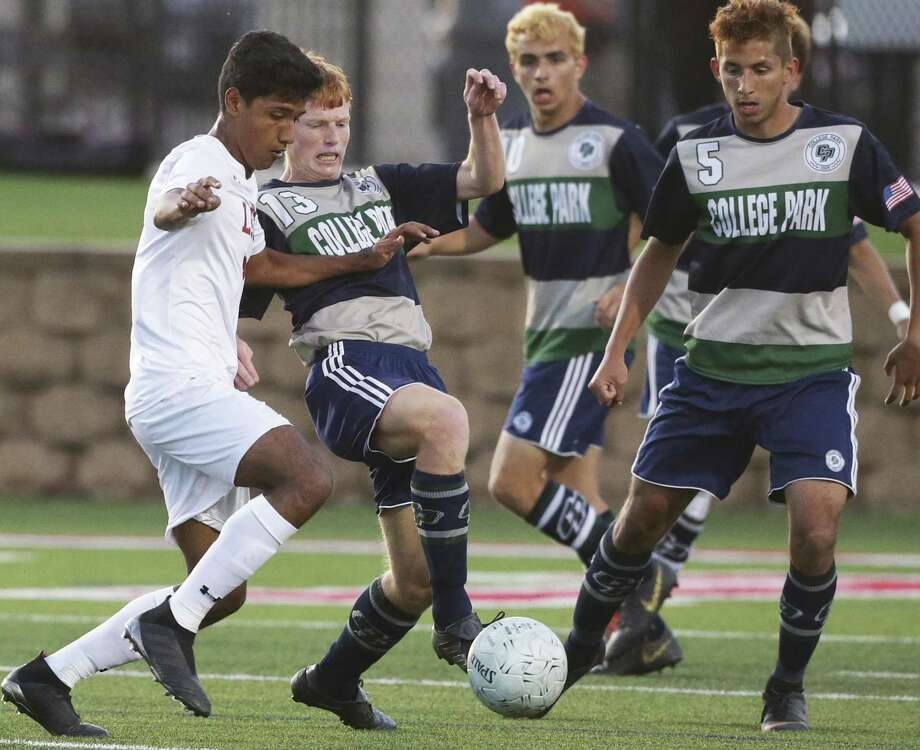 Antonio Loyola battles the Cavaliers Jonathon Letai, 13, as LEE plays The Woodlands College Park in the UIL Class 6A boys state soccer semifinals at Birkelbach Field in Georgetown on April 19, 2019. Photo: Tom Reel, Staff / Staff Photographer / 2019 SAN ANTONIO EXPRESS-NEWS
