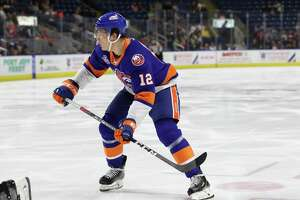Otto Koivula (12) of the Bridgeport Sound Tigers watches his shot head to the net during the round 1 game 1 AHL Calder Cup playoffs game between the Bridgeport Sound Tigers and the Hershey Bears on April 19, 2019 at the Webster Bank Arena in Bridgeport, CT.