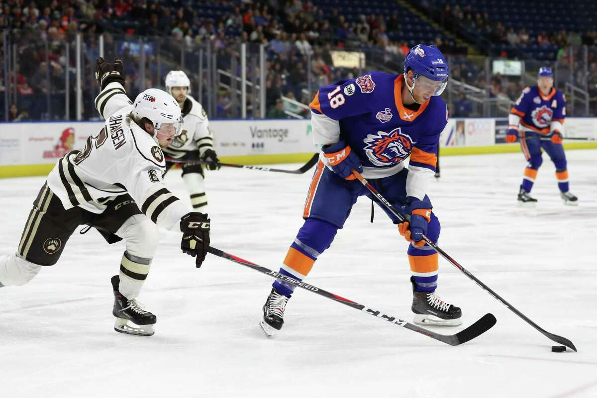 John Stevens (18) of the Bridgeport Sound Tigers controls the puck as Lucas Johansen (6) of Hershey looks to defend during the round 1 game 1 AHL Calder Cup playoffs game between the Bridgeport Sound Tigers and the Hershey Bears on April 19, 2019 at the Webster Bank Arena in Bridgeport, CT.