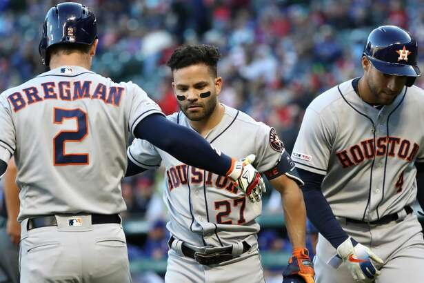ARLINGTON, TEXAS - APRIL 19: Jose Altuve #27 of the Houston Astros celebrates a two- run homerun with Alex Bregman #2 of the Houston Astros in the first inning against the Texas Rangers at Globe Life Park in Arlington on April 19, 2019 in Arlington, Texas. (Photo by Ronald Martinez/Getty Images)