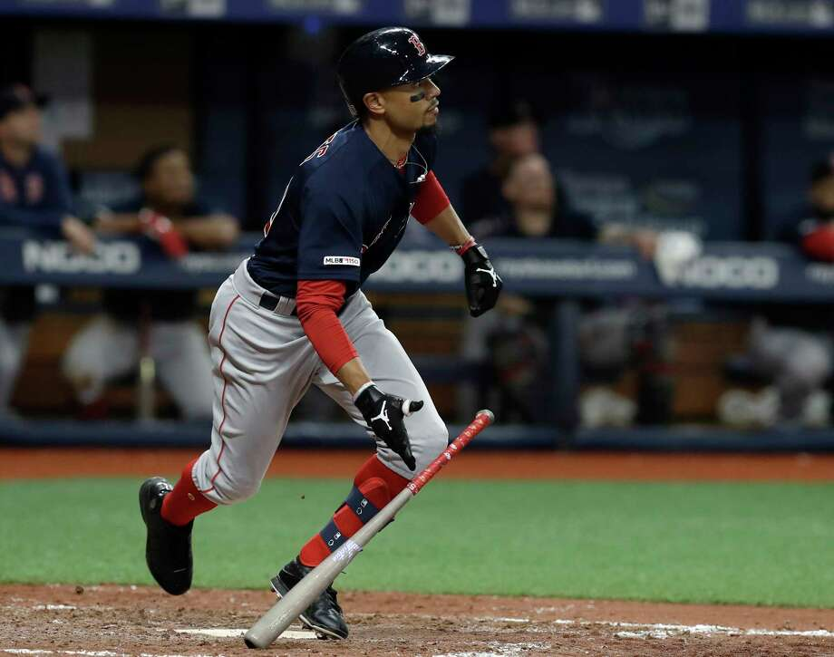 Boston Red Sox's Mookie Betts watches his home run off Tampa Bay Rays relief pitcher Diego Castillo during the eighth inning of a baseball game Friday, April 19, 2019, in St. Petersburg, Fla. (AP Photo/Chris O'Meara) Photo: Chris O'Meara / Copyright 2019 The Associated Press. All rights reserved.