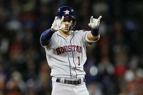 Houston Astros' Carlos Correa celebrates his RBI double during the fifth inning of a baseball game against the Texas Rangers, Friday, April 19, 2019, in Arlington, Texas. (AP Photo/Brandon Wade)