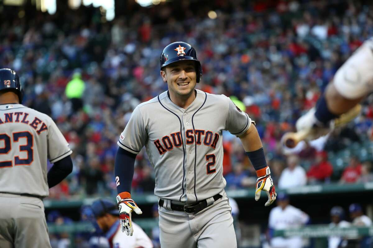 ARLINGTON, TEXAS - APRIL 19: Alex Bregman #2 of the Houston Astros celebrates a homerun in the first inning against the Texas Rangers at Globe Life Park in Arlington on April 19, 2019 in Arlington, Texas. (Photo by Ronald Martinez/Getty Images)