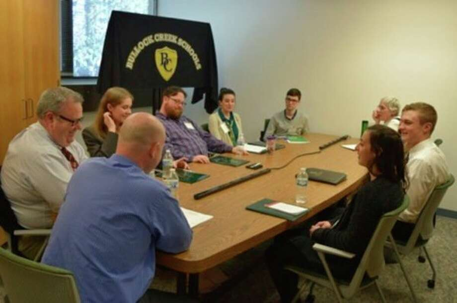 Teaching students meet with representatives of Bullock Creek Schools. (Photo provided)