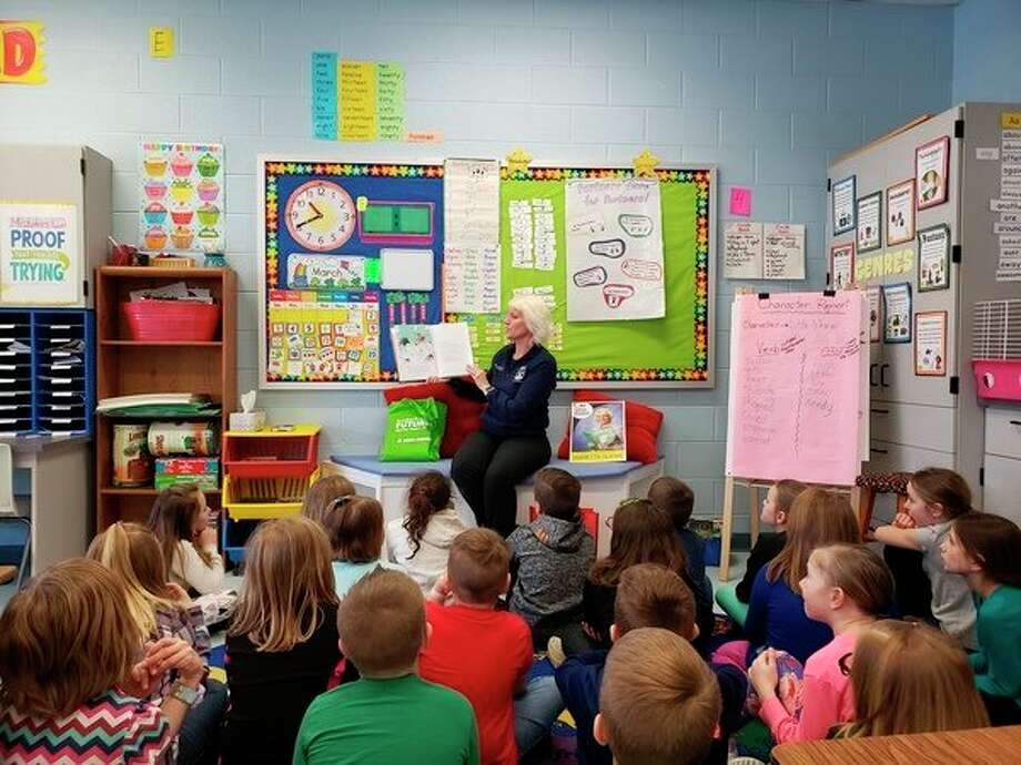 State Rep. Annette Glenn reads to students during her March is Reading Month tour in Midland County. (Photo provided)