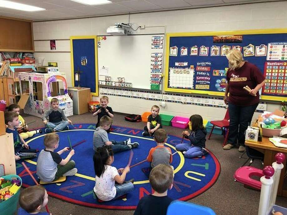 St. John's Lutheran Preschool children picked some of their other favorite things to do, including visiting the library for a story and making music. (photo provided)