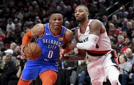 PORTLAND, OR - APRIL 14: Russell Westbrook #0 of the Oklahoma City Thunder drives to the basket on Damian Lillard #0 of the Portland Trail Blazers in the second of Game One of the Western Conference quarterfinals during the 2019 NBA Playoffs at Moda Center on April 14, 2019 in Portland, Oregon. NOTE TO USER: User expressly acknowledges and agrees that, by downloading and or using this photograph, User is consenting to the terms and conditions of the Getty Images License Agreement.   (Photo by Steve Dykes/Getty Images)