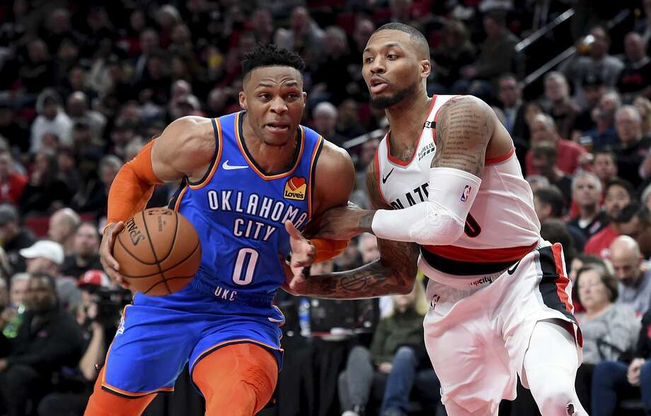 Russell Westbrook #0 of the Oklahoma City Thunder drives to the basket on Damian Lillard #0 of the Portland Trail Blazers in the second of Game One of the Western Conference quarterfinals during the 2019 NBA Playoffs at Moda Center on April 14, 2019 in Portland, Oregon. Photo: Steve Dykes/Getty Images