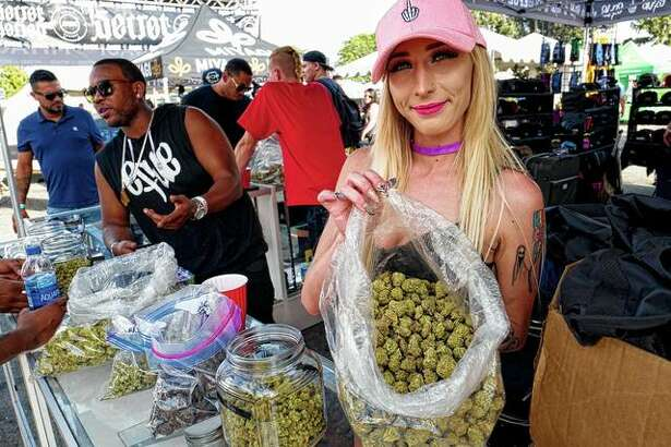 "A bud tender offers attendees the latest products of cannabis at the High Times 420 SoCal Cannabis Cup on April 21, 2018, in San Bernardino, California. Businesses inside and outside the multibillion-dollar cannabis industry are using today - April 20, or ""420"" - to roll out marketing and social media messaging aimed at connecting with marijuana enthusiasts."