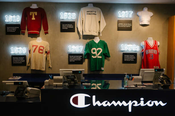 A historical timeline of Champion apparel is displayed at the company's store in Philadelphia on April 10, 2019.
