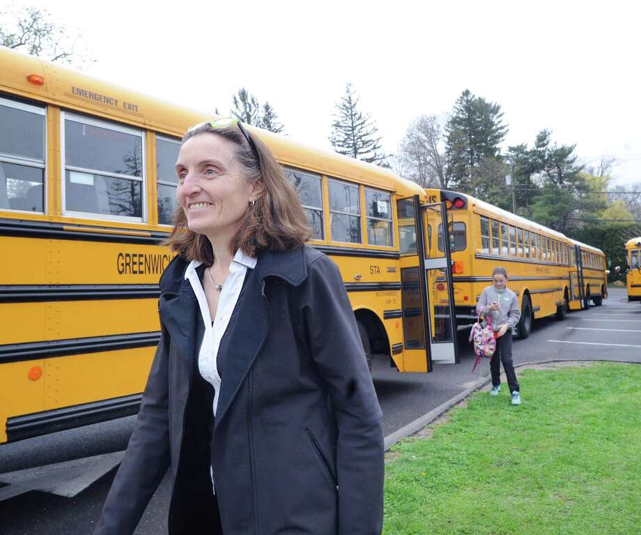 "Students participate in ""Tiger Rides,"" an Earth Day inspired program designed to encourage bus riding and carpooling for a better environment at Greenwich Country Day School in Greenwich, Conn., Friday, April 21, 2017. Greenwich Country Day School Sustainability Director Laura di Bonaventura, pictured here, said that 90 GCDS students are participating in the program by riding the town school bus and that 200 GCDS students are carpooling participants. Photo: File / Hearst Connecticut Media / Greenwich Time"