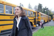 """Students participate in """"Tiger Rides,"""" an Earth Day inspired program designed to encourage bus riding and carpooling for a better environment at Greenwich Country Day School in Greenwich, Conn., Friday, April 21, 2017. Greenwich Country Day School Sustainability Director Laura di Bonaventura, pictured here, said that 90 GCDS students are participating in the program by riding the town school bus and that 200 GCDS students are carpooling participants."""