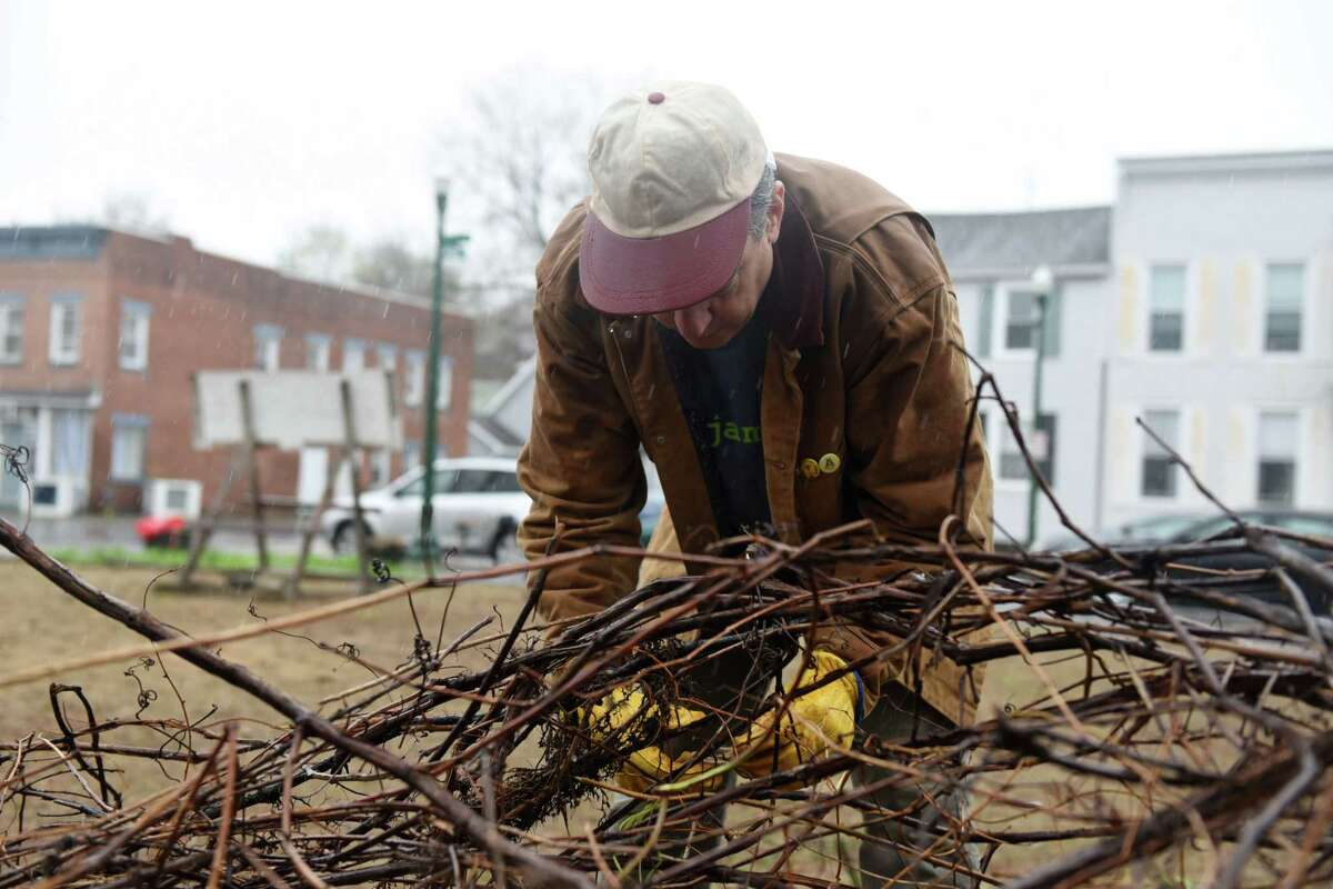 Pete Dott ties together a bushel of branches on Saturday, April 20, 2019 at the Lots of Hope site in Troy, NY. (Phoebe Sheehan/Times Union)