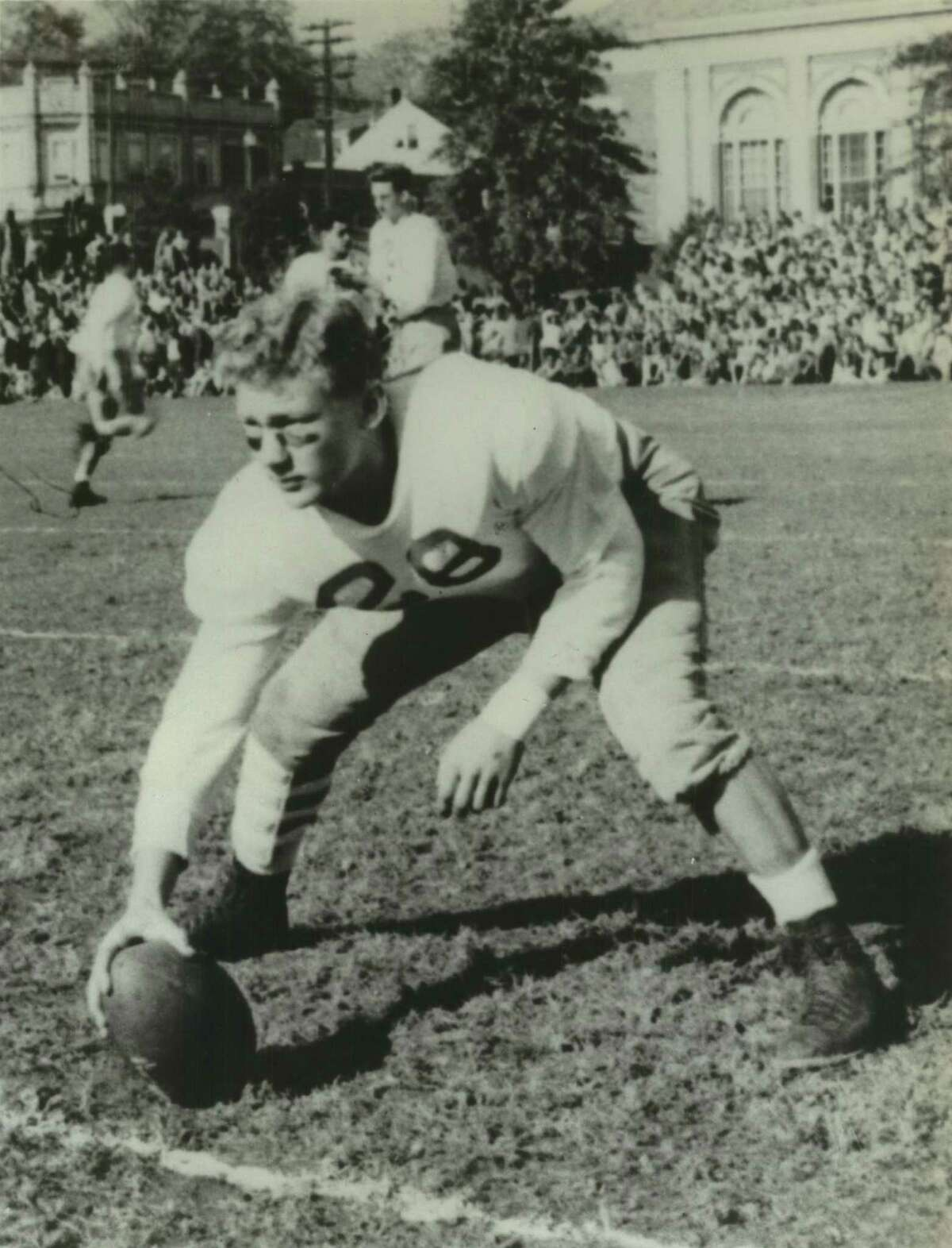 """As a 160-pound center for Montclair High School in Montclair, New Jersey, Buzz Aldrin had a unique talent. """"I was the only guy who centered for a punt with one hand,"""" he says. He attended Montclair High from 1943-1947 and worked as a dishwasher after school."""