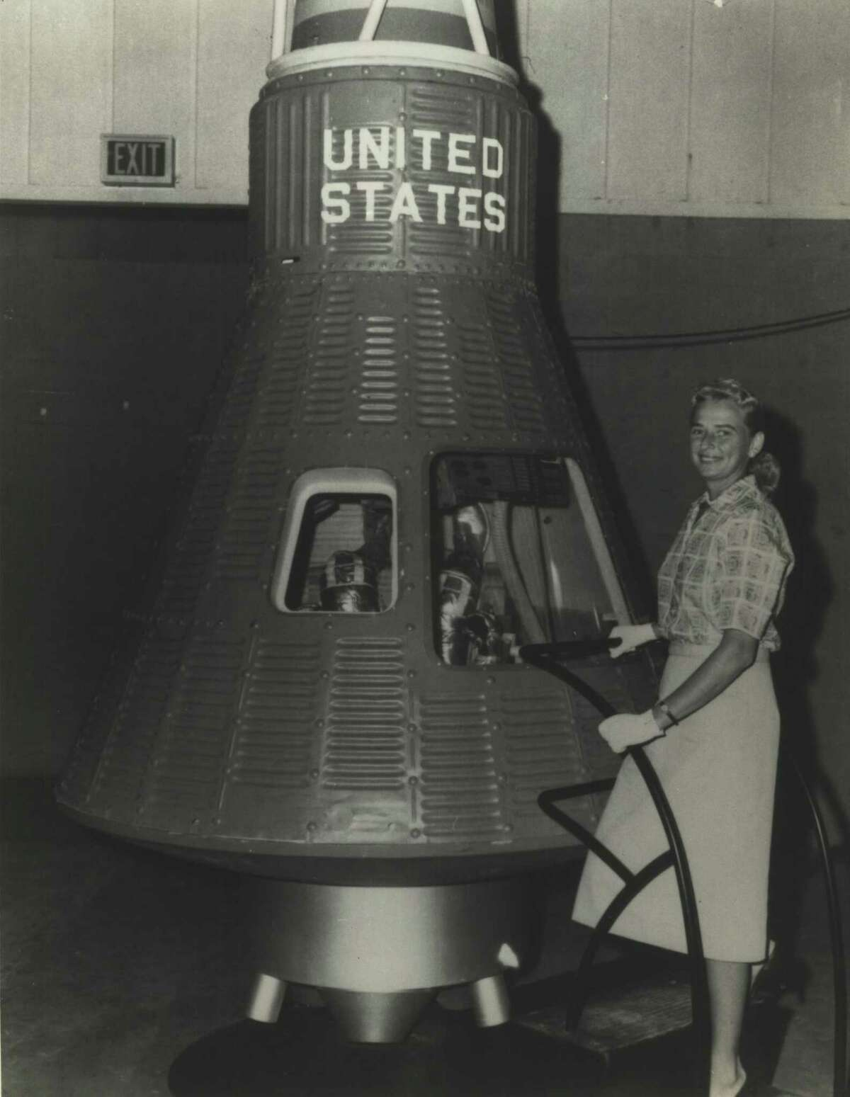Sometimes referred to as America's first woman astronaut, pilot Jerrie Cobb was the first woman to pass the astronaut physical tests in NASA's Mercury program. She stands here by a prototype of a Mercury spacecraft. NASA abandoned plans for women astronauts, however, and Cobb never made it into space. She was one of the Mercury 13 - thirteen women tested to be astronauts until NASA shut down the program in the 1960s.