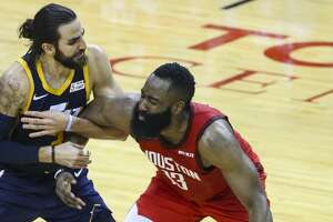Utah Jazz guard Ricky Rubio (3) guards Houston Rockets guard James Harden (13) during the second half of game 2 of the NBA playoffs at the Toyota Center in Houston, Wednesday, April 17, 2019.