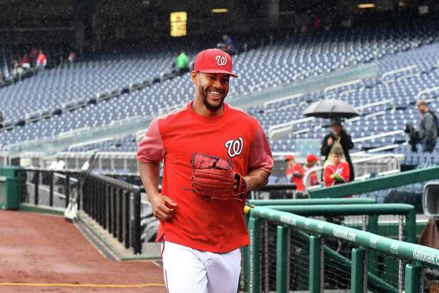 Washington Nationals starting pitcher Joe Ross (41) laughs as he comments on a cold rain before the game against the New York Mets at Nationals Park for the last home stand of the season September 23, 2018 in Washington, DC.