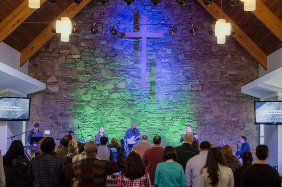 The sanctuary at Broad River Church, New Canaan Avenue, Norwalk. Below, Pastor Kevin Mullins. Photo: Contributed Photos