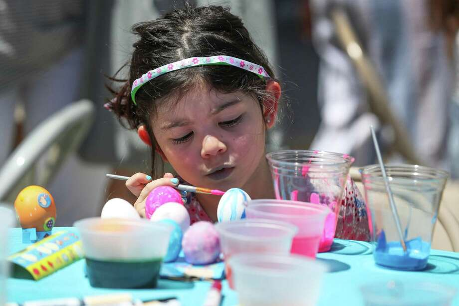 Bailey McNealy, 5, paints eggs at the Czech Center Museum Houston Saturday, April 20, 2019, in Houston. Photo: Steve Gonzales, Houston Chronicle / Staff Photographer / © 2019 Houston Chronicle