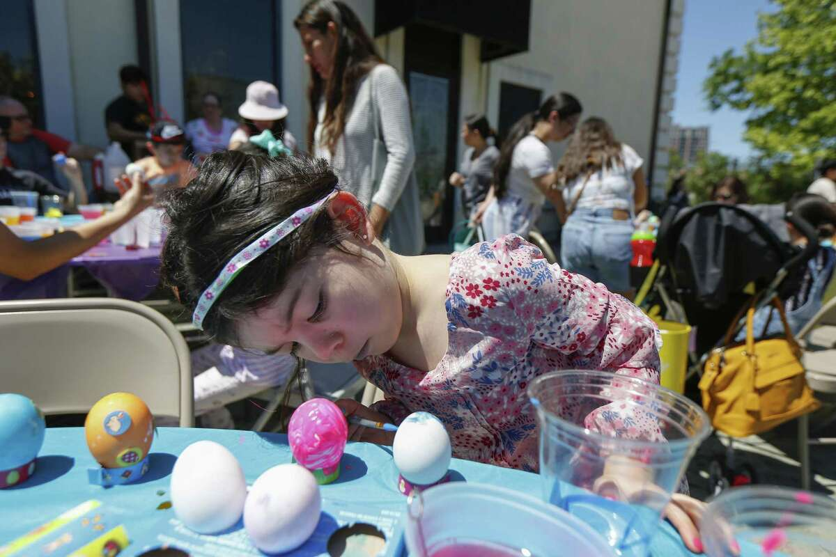 Bailey McNealy, 5, paints eggs at the Czech Center Museum Houston Saturday, April 20, 2019, in Houston.