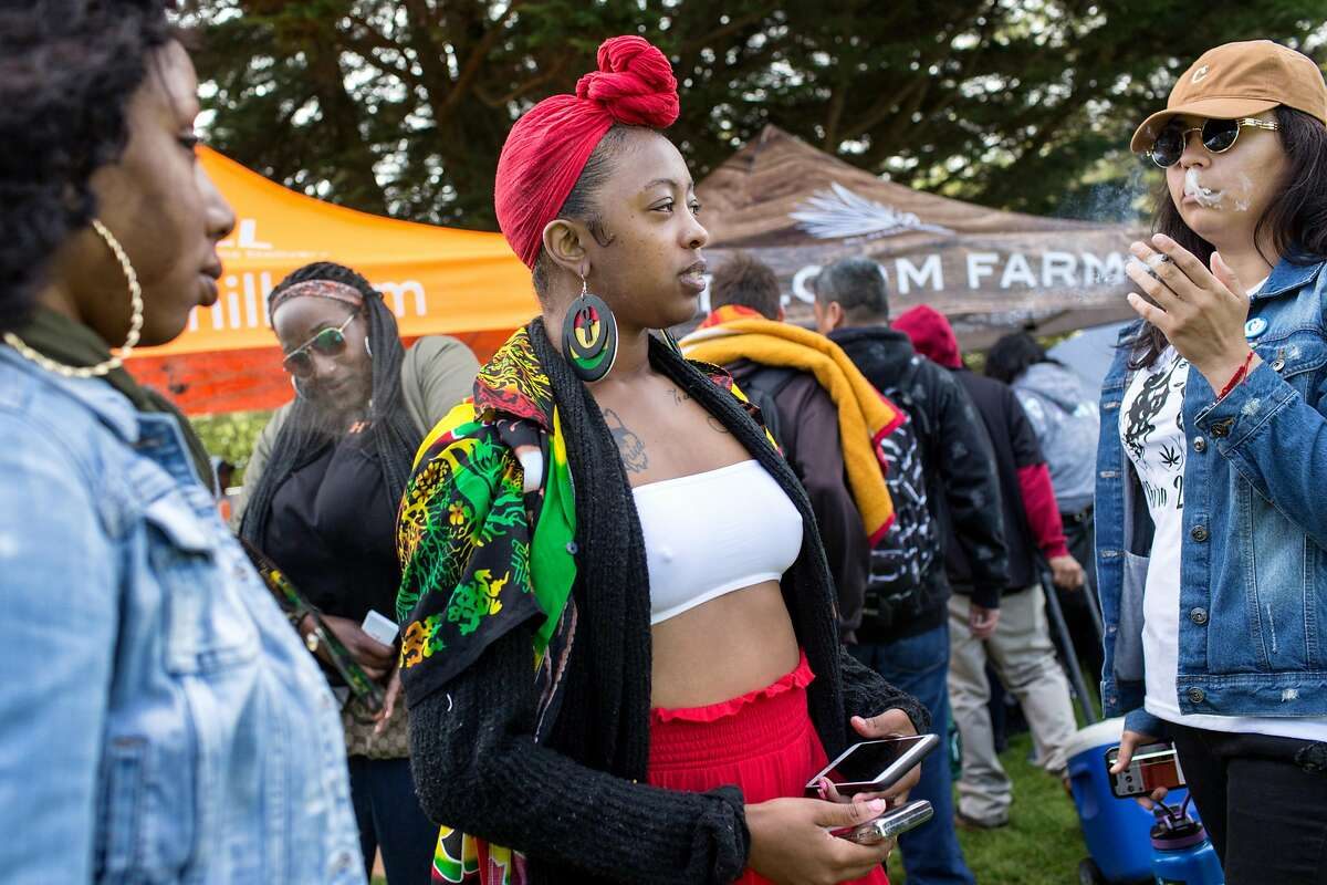 Nikita Frierson, left, Jonnae Penermon, center and Raquel Quintana, share a joint during the annual 420 in the Park pot festival at Hippie Hill in Golden Gate Park. Saturday, April 20, 2019. San Francisco, Calif.
