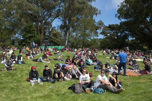 People arrive to the annual 420 in the Park pot festival at Hippie Hill in Golden Gate Park. Saturday, April 20, 2019. San Francisco, Calif.