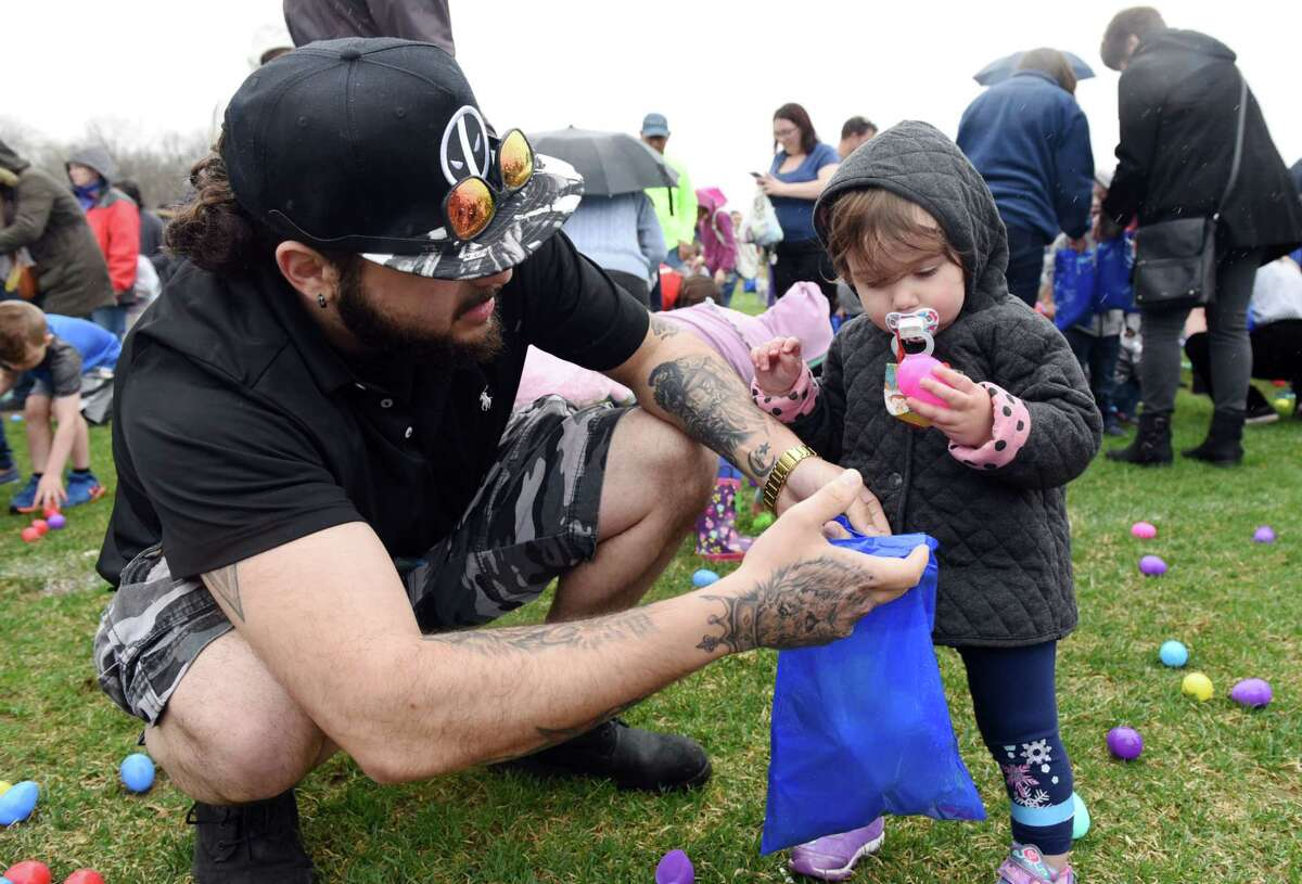 Tyler Giglia and his daughter, Daniella Giglia, 1.5, search for eggs during the Easter Egg hunt on Saturday, April 20, 2019 at the Skano athletic fields in Clifton Park, NY. (Phoebe Sheehan/Times Union)